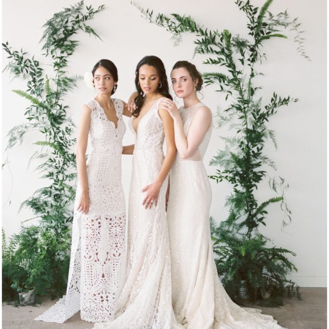 three girls standing in 2017 bridal gowns