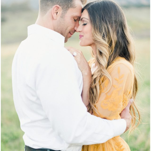 couple closing their eyes in boulder colorado for their engagement session on film