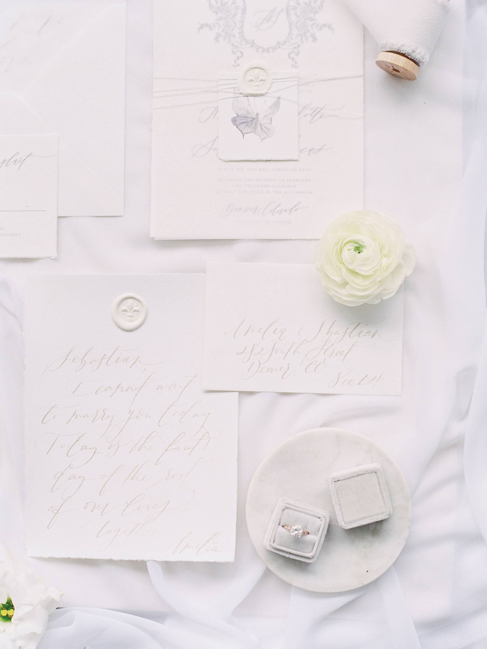 Fine Art Colorado Wedding Photography worked with Kelsey Malie Calligraphy to capture this beautiful invitation suite