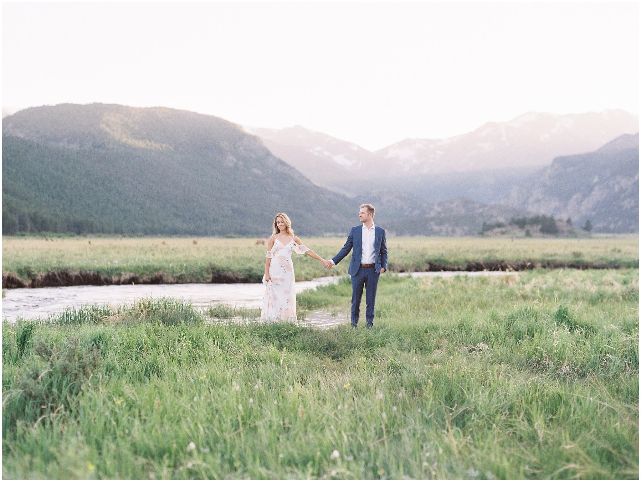 Couple standing during Rocky Mountain National Park Engagement Session