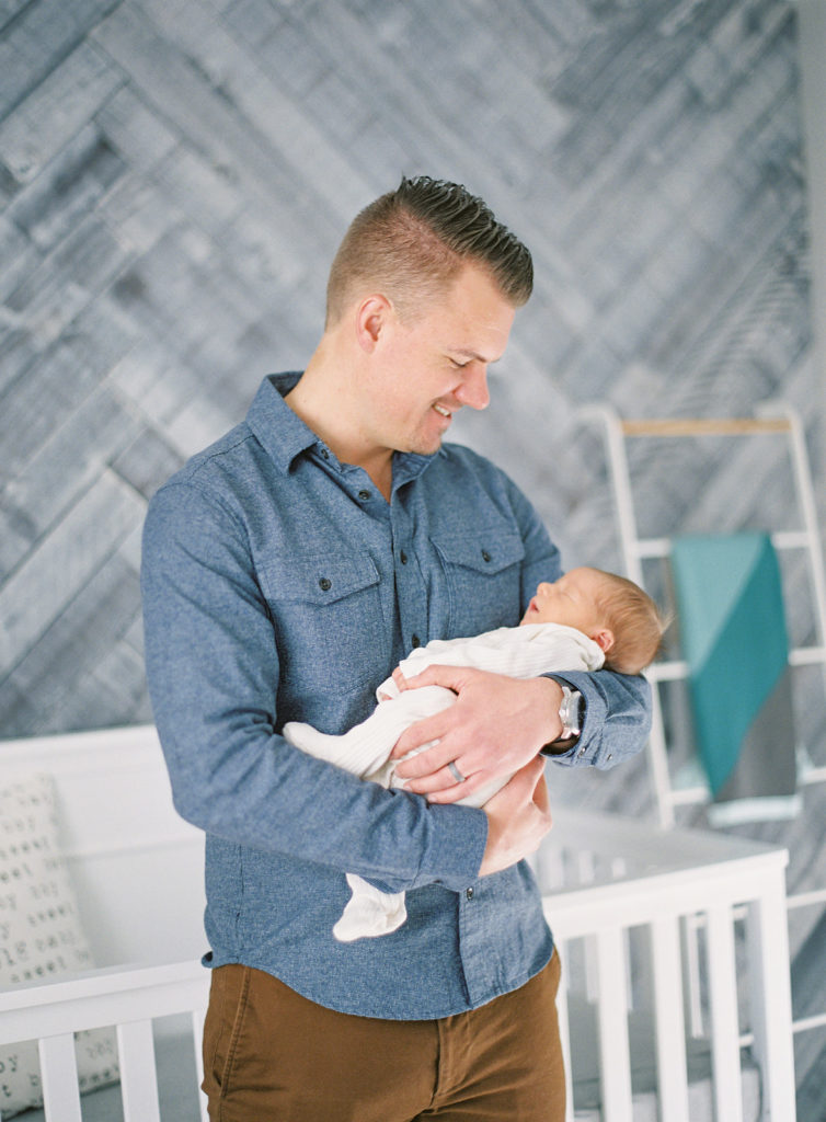 dad holding baby in Denver newborn session Modern denver newborn session