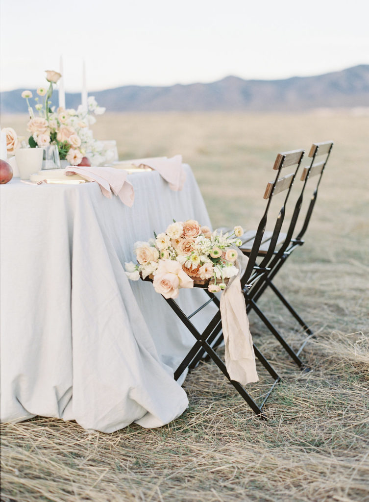 Colorado Romantic Spring Elopement bouquet sitting on chair by flora by