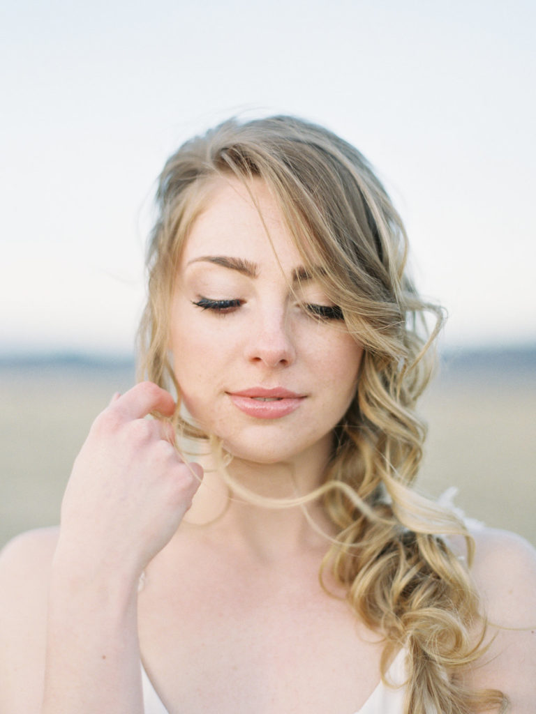 Colorado Romantic Spring Elopement a bride looking down makeup by Ally triolo