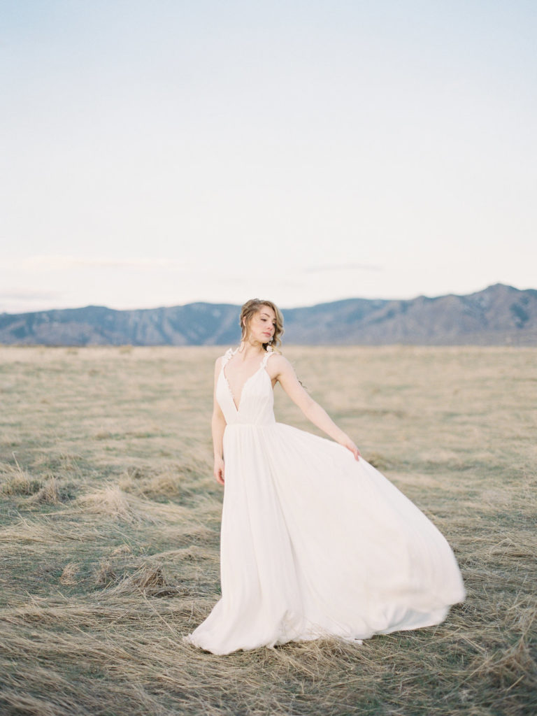 bride's wedding gown blowing in the wind