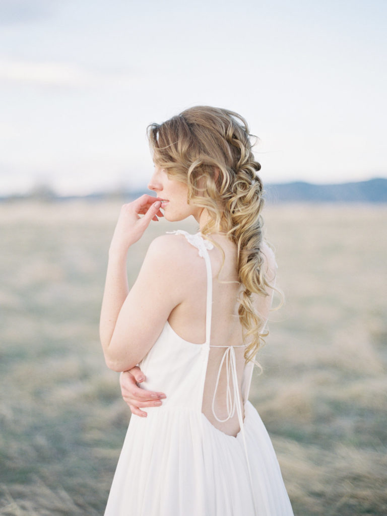 Colorado Romantic Spring Elopement bride looking into the distance in her wedding dress