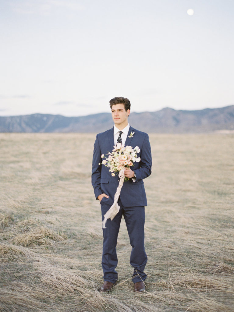 Colorado Romantic Spring Elopement groom holding wedding bouquet by flora by nora
