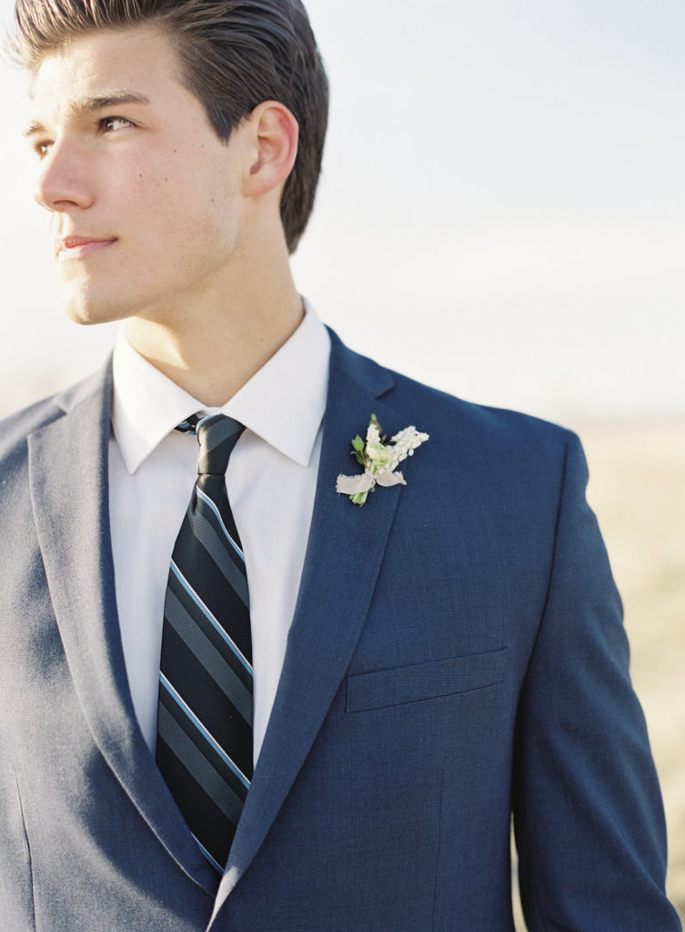 Colorado Romantic Spring Elopement groom looking dapper in a navy suit