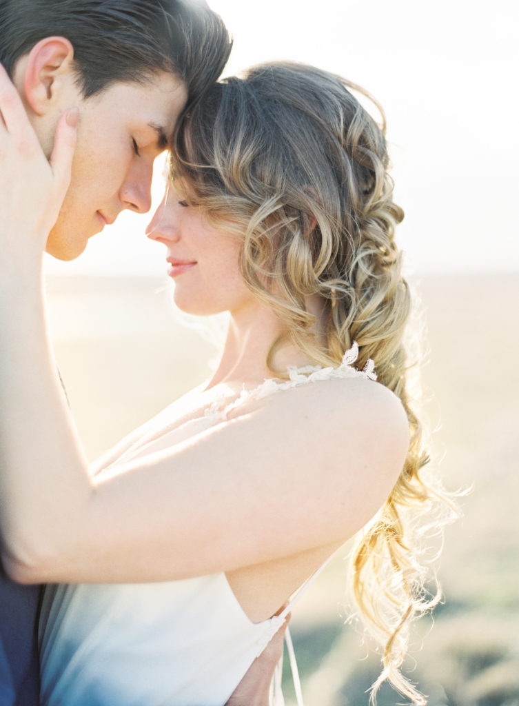 Colorado Romantic Spring Elopement bride and groom illuminated by the sun during the sunrise
