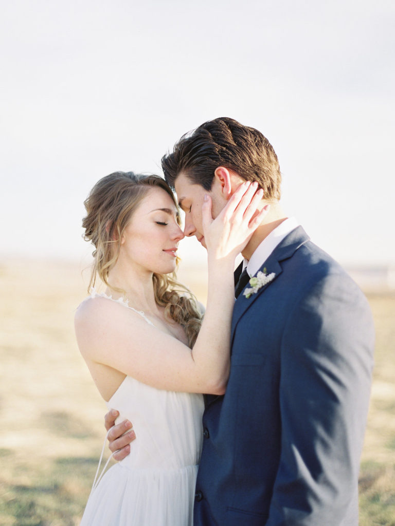 Colorado Romantic Spring Elopement bride and groom loving on each other