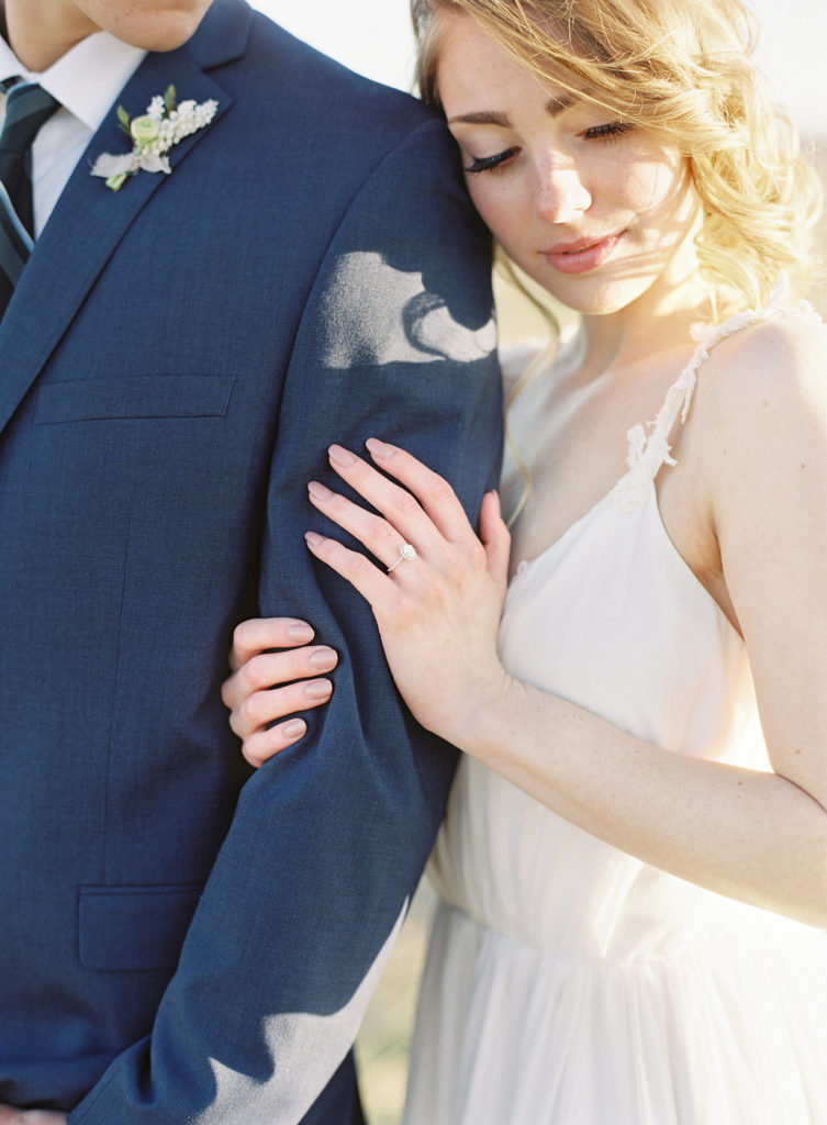 bride with her head on groom's shoulder Colorado Romantic Spring Elopement