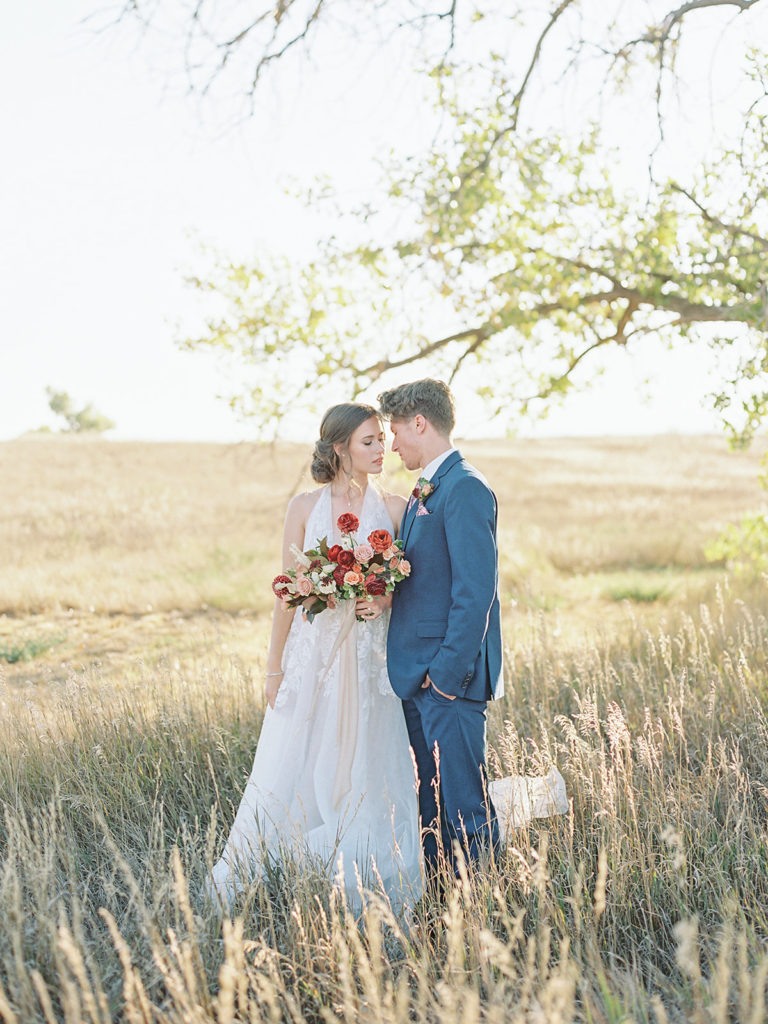 Bride and groom sharing an intimate moment photographed by Decorus photography during a Romantic Al Fresco Wedding Inspiration at Stonewall Farm