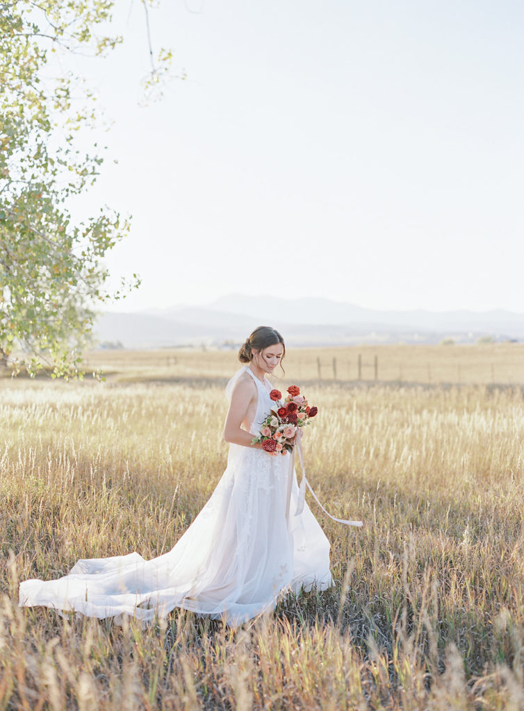 Bride walking in front of Stonewall Farm photographed by Decorus photography during a Romantic Al Fresco Wedding Inspiration at Stonewall Farm