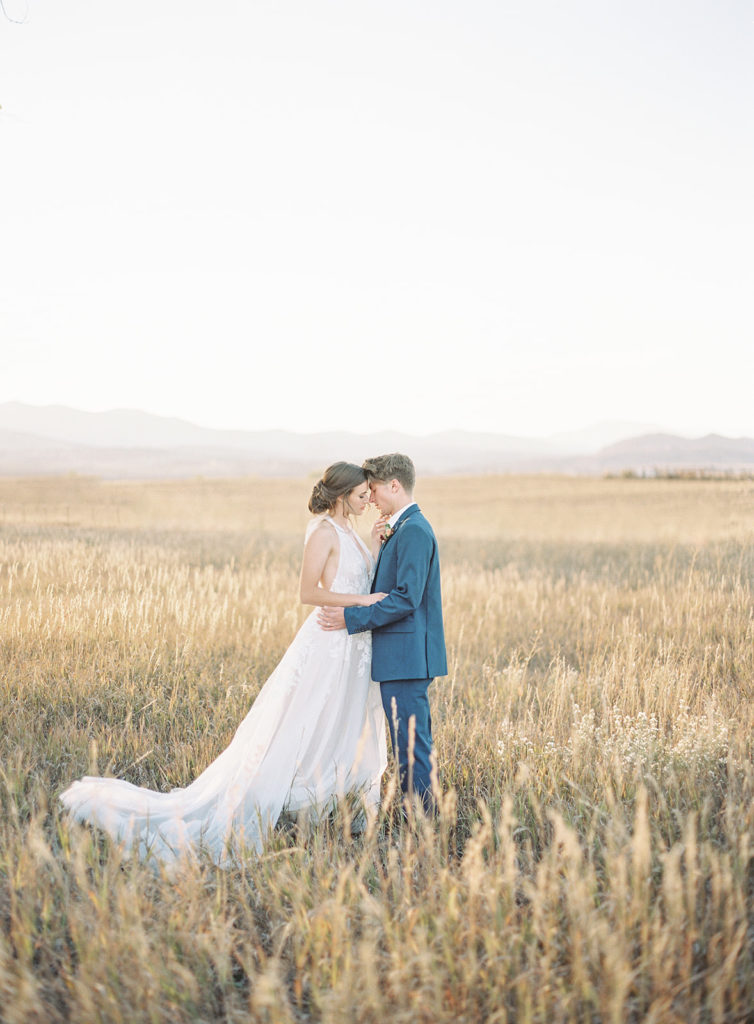 Bride and groom standing in front of Stonewall Farms during a Romantic Al Fresco Wedding Inspiration wedding at Stonewall Farm