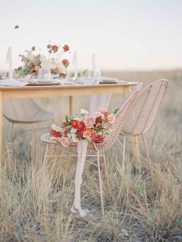 Bouquet laying on an Urban Outfitters rattan chair shot by Decorus Photography during a Romantic Al Fresco Wedding Inspiration photoshoot at Stonewall Farm