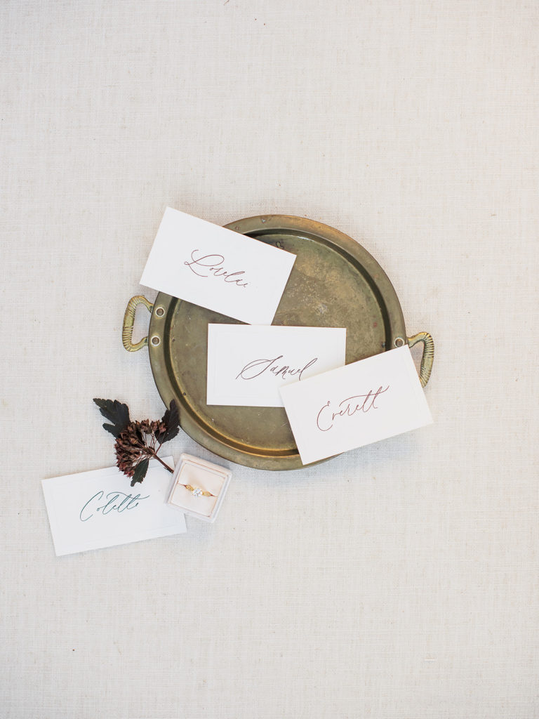 Beautiful hand lettered name tags designed by Abbey Ratcliff photographed by Decorus photography during a Romantic Al Fresco Wedding Inspiration at Stonewall Farm