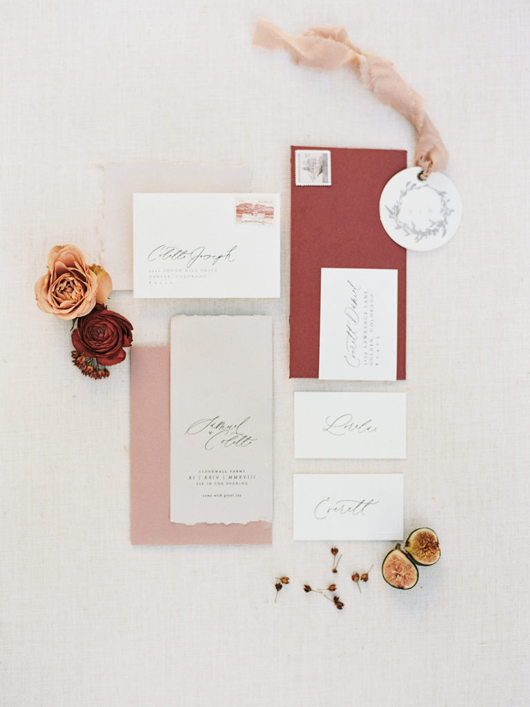 Beautiful hand lettered invitation suite by Abbey Ratcliff for our Romantic Al Fresco Wedding Inspiration at Stonewall Farm