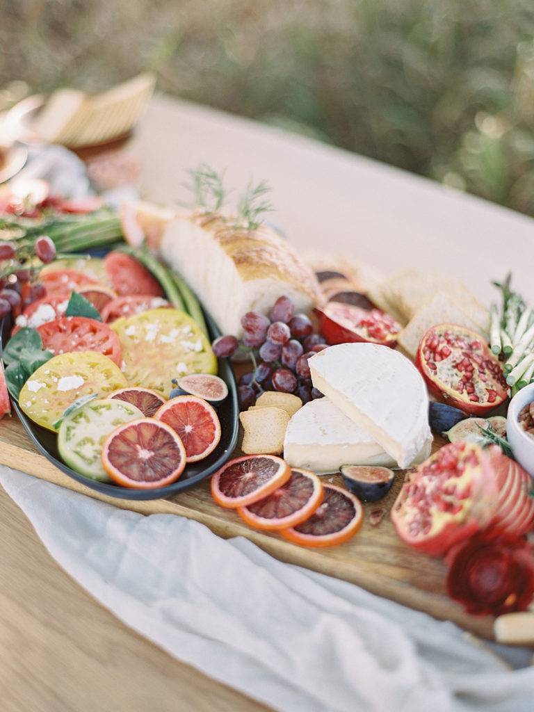 Grazing table with cheese fruits and meat created by Rocky Mountain Catering photographed by Decorus photography during a Romantic Al Fresco Wedding Inspiration at Stonewall Farm